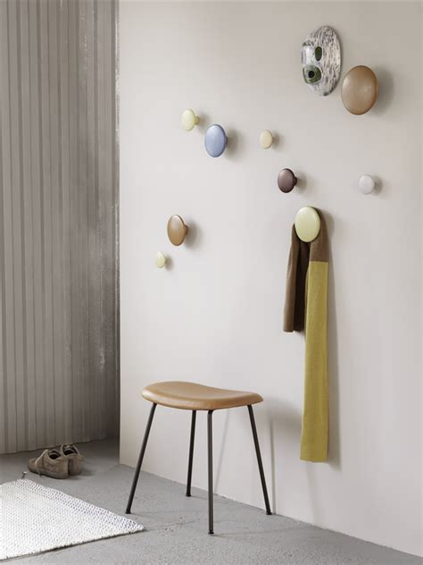 bronze wall the dots get playful with wooden coat hooks