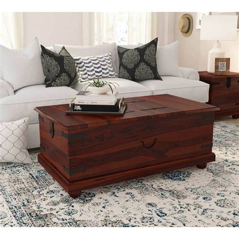 This coffee table delivers a versatile design to help you maximize your living room. Kokanee Rustic Solid Wood Double Top Storage Trunk Coffee ...
