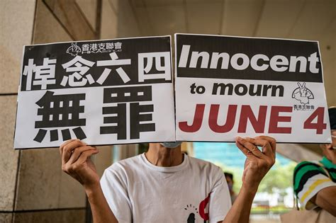 Hong Kong democracy activists face court over banned ...
