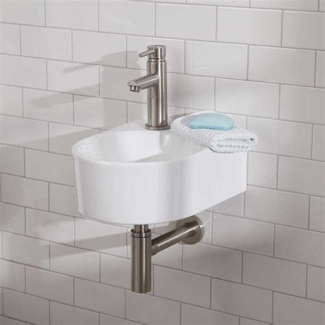 Round White Sink With Small Shape Combined With Silver