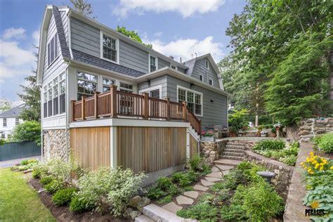 addition porch overlooking garden pegasus design  build