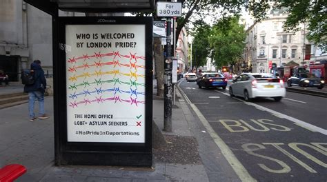 lgbt activists hack bus stop adverts  protest