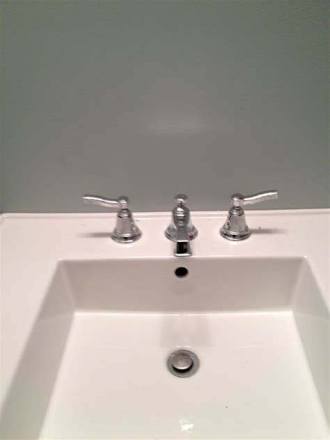 lighting a match in the bathroom does my bath hardware need to match my faucet or light