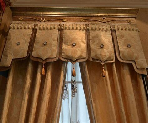 crown molding topped cornice board with fabric