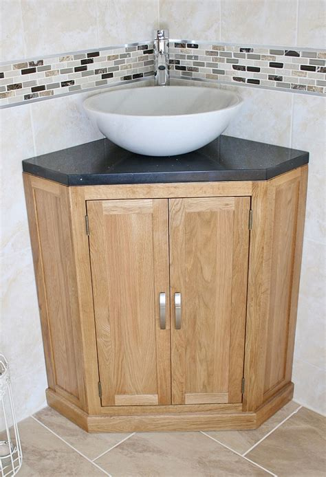 sink on top of vanity brown wooden vanity with drawers on the middle of the