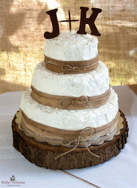 3 Tier Wedding Cake Decorated With Burlap Ribbon And Twine