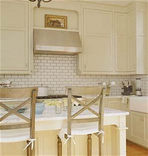 cream backsplash with white cabinets cream cabinets white subway tile w grey grout my kitchen