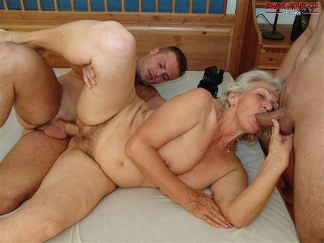 kinky grandma doing two dudes at the same time