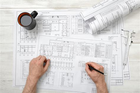 Close-up Hands Of Architect Working With Pencil On A Drawing Stock Image