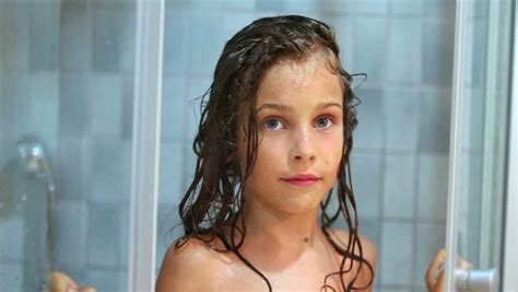 girl closes shower unit stock footage video