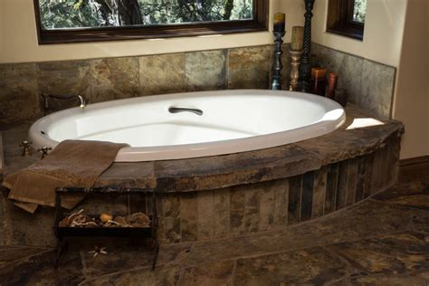 rustic bath tubs water tower inspired home master bath suite soaking tub rustic bathroom other metro by