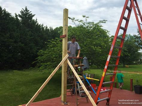 installing a l post photos remodelaholic diy pergola tutorial how to build your