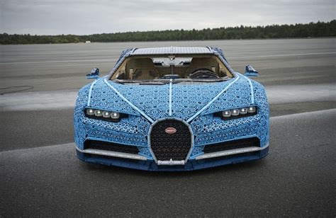 More than a million lego technic pieces and thousands of lego motors came together to make this bugatti that can drive up to 18 miles per hour. This full-size LEGO Bugatti Chiron actually runs and drives   Driving