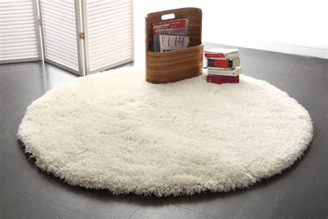 tapis shaggy rond blanc 150 cm ugo miliboo