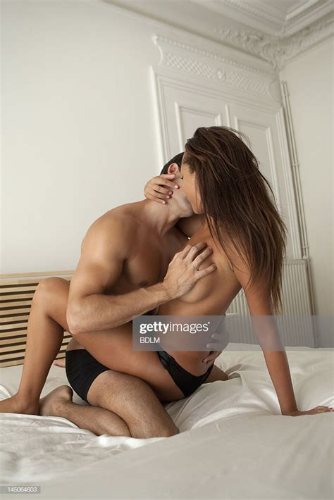 Nude Couple Kissing In Bed Highres Stock Photo Getty Images