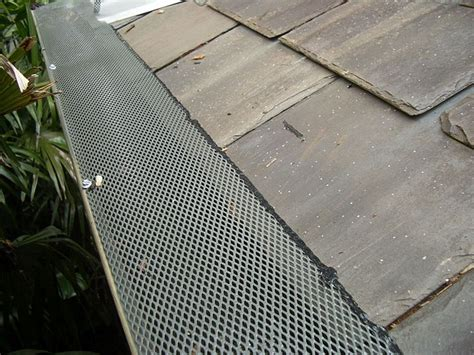 decorating with leaf guards best 25 gutter guards ideas on gutter mesh gutter leaf guard and roof cleaning