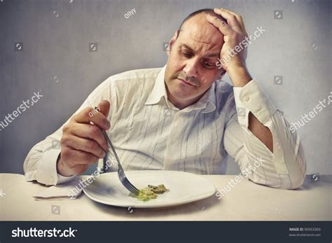 Sad Fat Man Eating Vegetables Stock Photo 90953369