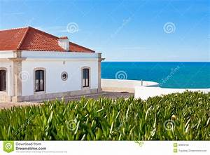 Turquoise Sea, Blue Sky And White House In Portugal Stock ...