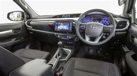 toyota hilux pickup interior dashboard satnav carbuyer