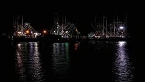 Fishing Boats At Night Photograph by Louis Dallara