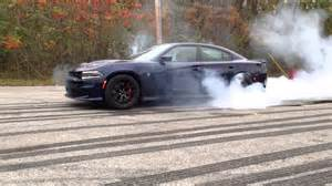 2012 dodge charger blacked out dodge charger hellcat burnout wallpaper 1920x1080 32576