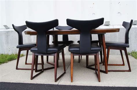 rosewood dining table and six chairs by arne vodder for