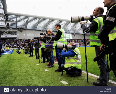 15088 sports photographers taking pictures sports photographers at a football match stock photo