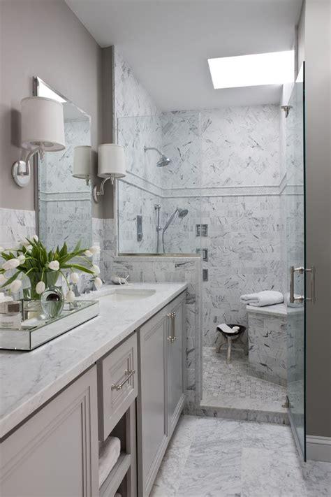 master bath gray carrara marble herringbone tile