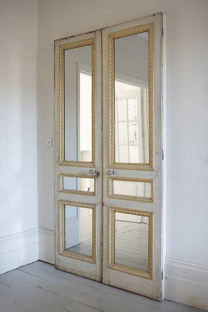 pair   doors  mirror inserts   plain wall