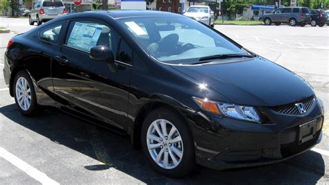 The extra doors, bigger rear seats, and more useful trunk obviously set the sedan apart, but. 2012 Honda Civic Coupe 2-Door Automatic DX PZEV