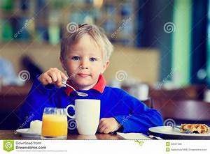 Little Boy Eating Breakfast In Cafe Stock Photo - Image of ...