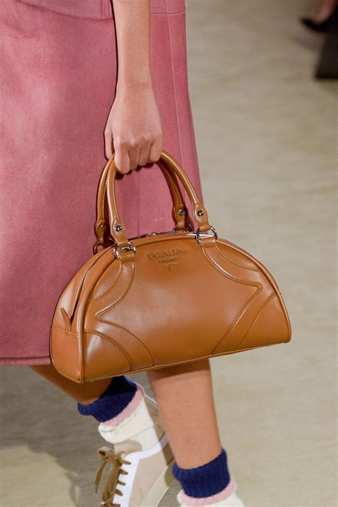 prada  introduces  iconic bowling bag  resort