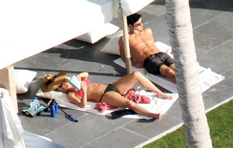 jennifer aniston   bikini  justin theroux  mega douchey jean shorts  hat  cabo  christmaslainey gossip entertainment update