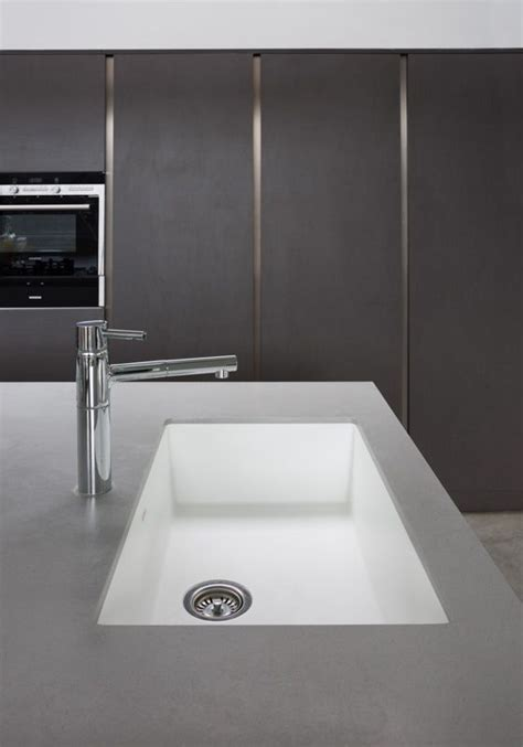 Grey Corian Countertops by Sink Tap Surrounded With Dove Grey Corian For The