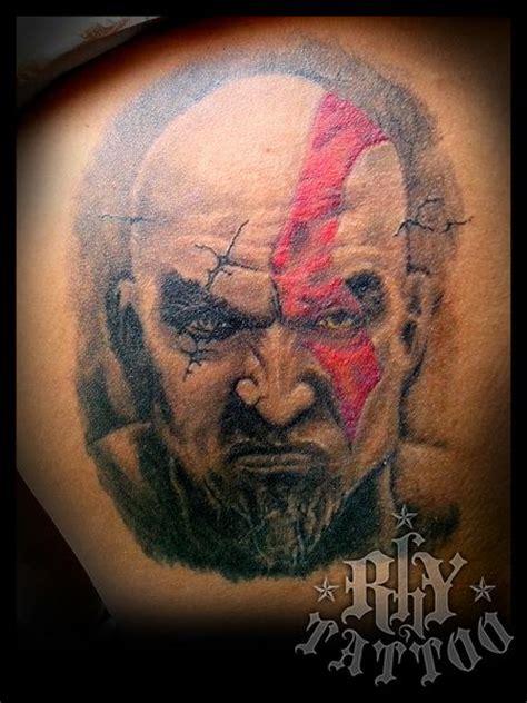 healed kratos portrait tattoo    tattoo