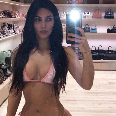 evehewson sexy kim kardashian bares a bikini and major birkin collection