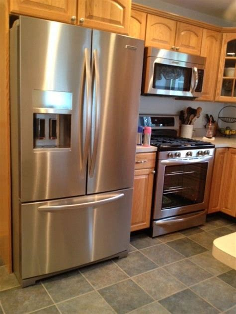oak floor kitchen oak cabinets gray walls and floor kitchen dining 1135