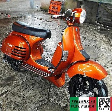 custom modified orange vespa px 200 racing style with 12