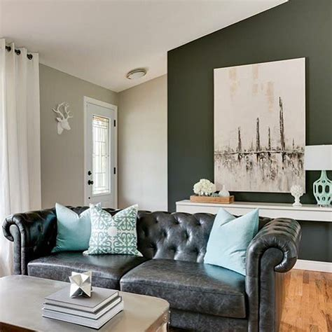 black sofa living room ideas black leather chesterfield sofa with turquoise pillows