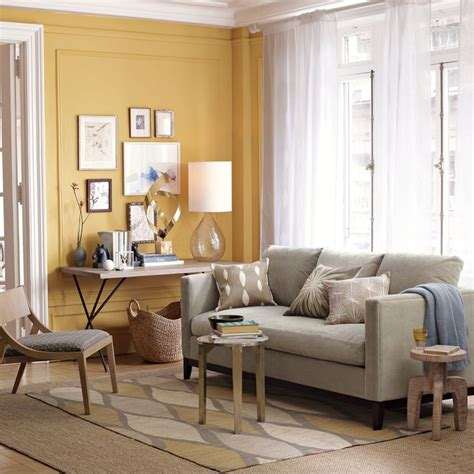 love this yellow accent wall and grey couch west elm