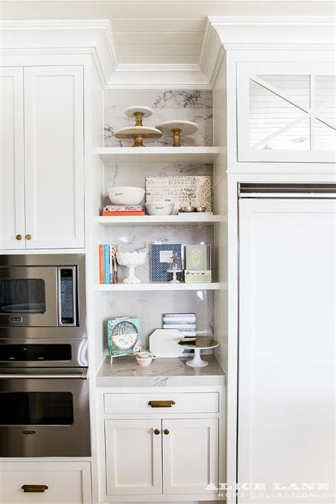 styled kitchen shelves  marble cake stands