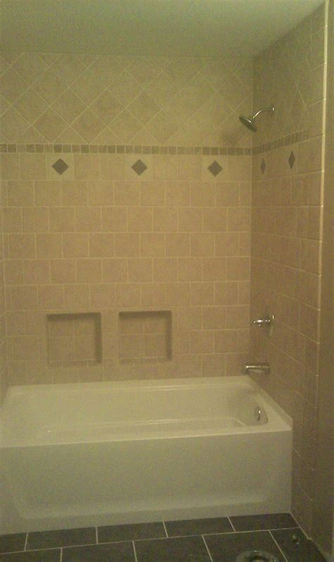 fiberglass bath tub  fancy  custom tile wall
