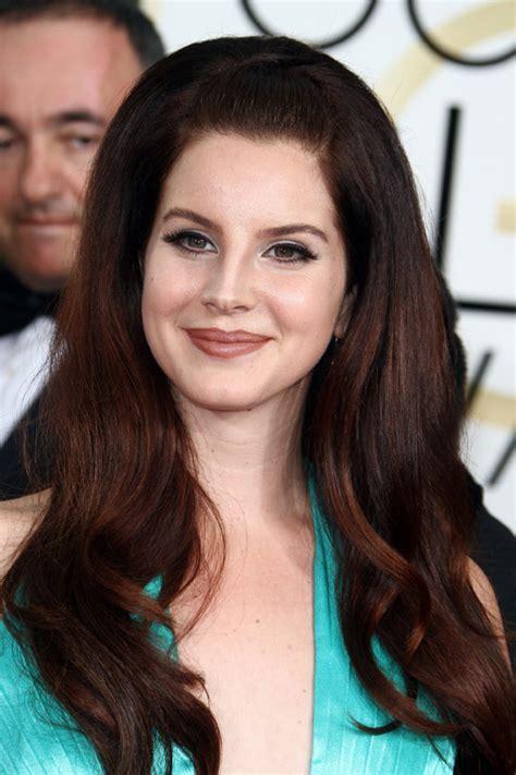 Lana Del Rey Wavy Auburn Bouffant Pompadour Hairstyle