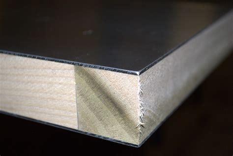 extreme close  corner  sing aluminum panel composite  wood frame exposed  warping