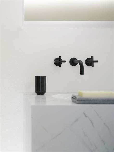 tara wall mount lavatory faucet in black dornbracht