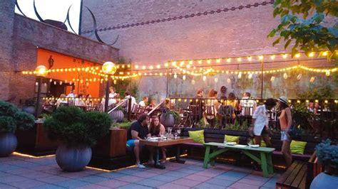 outdoor restaurant with string lights decoist