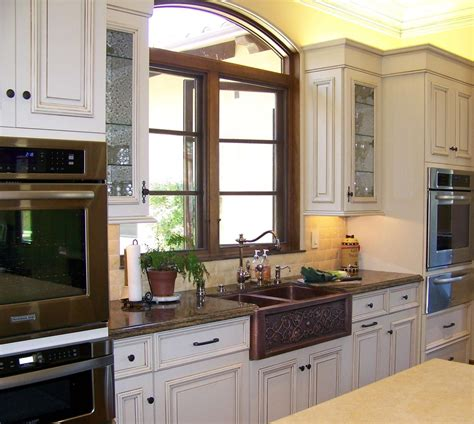 copper sink with stainless steel appliances kitchen sink window height kitchen traditional with faux