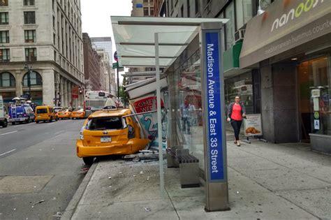 cab crashes  madison avenue bus stop injuring