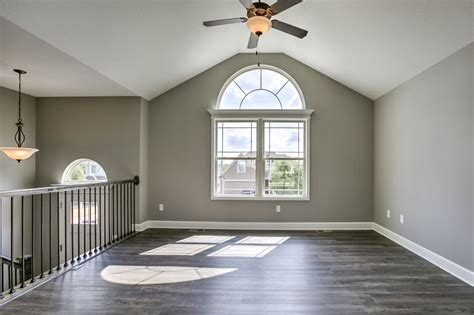 sherwin williams walls  pussywillow trim  origami white railing stained  ebony
