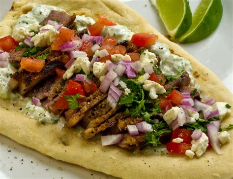gyros recipe lime marinated steak gyros with tzatziki sauce tomatoes onions feta mint